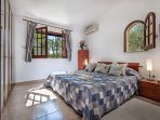 The master bedroom with super kingsize bed in main villa