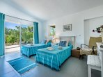Twin bedroom in main villa with views over the front garden