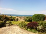 View from kitchen window of bottom garden and sea