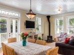 flat screen TV, doors to porch, dining