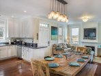 Large, farm-style dining room table, gas fireplace