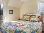 Second bedroom with queen Posturepedic mattress, walk-out deck on the second floor