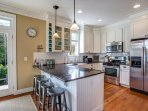 Full-stocked kitchen with stainless steel appliances and granite countertops