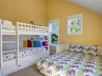 Bunk bedroom with extra-long twins and daybed pulls out to a queen bed