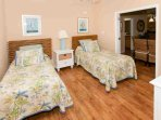 Guest room with two twin beds located off dining room