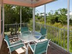 Screened porch with dining table for 4