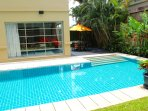 Luxury Private villa with large pool, outdoor dining and tropical gardens.