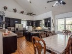 A great view of the large open air/high ceiling and airy feel kitchen and dining area