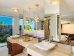 Ocean Suite bathroom: twin luxury vanities, outdoor shower and separate toilet.