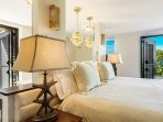 Oceanside suite includes fridge and sun deck with double loungers.
