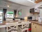 Kitchen: Two ring hob,worktop oven,microwave/grill,fridge/freezer,kettle,toaster,iron/iron board.