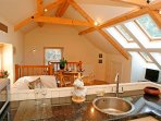 Open beamed into the cieling, 4 large Velux windows open out onto a view of fields and countryside
