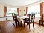 Spacious dining room with wooden floor and views to all elevations