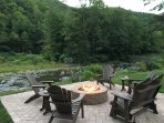 Relax on our new stone, stream side, patio with comfortable furniture & terrific seasonal fire pit!