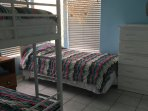 Third bedroom with bunk bed and twin bed