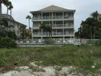 Back of Sunset Paradise and pool area with access to the beach (Gulf of Mexico)