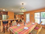 Gather around this charming dining table to enjoy family meals.