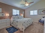 The second bedroom boasts a king-sized bed and ensuite bathroom as well!