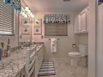 This pristine bathroom makes your morning preparations easy.