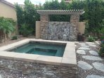 Courtyard jacuzzi and waterfall