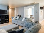 comfortable living room, pottery barn furniture, flat screen with smart DVD and Apple TV.