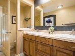 master bath, square Kohler sinks, tile floor, tile countertop