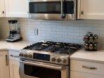 Commercial grade appliance package.  Gas 20,000 BTU GE Cafe appliances.  Double ovens & convect/micr
