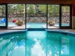 View of indoor/outdoor pool. Indoor area has steam, sauna and fitness room.