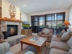 Curl up on the comfortable sofa (with sleeper) in front of the gas fireplace and flat screen TV after a hard day of...