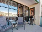 Enjoy coffee or cocktails on the cozy outdoor living space with seating for 2 and gas grill.