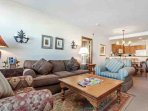 Open floor plan combining the living, dining and kitchen areas.  Bedrooms are private and on opposite sides of condo...