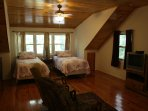 2nd floor, Burgundy Bedroom, has 2 twin XL on woods side and 2 twin on riverside w sitting between