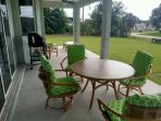 lanai, 2 ceiling fans, bamboo seating and tables, grill for your use.. now screened in!