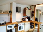 Fully-equipped kitchen with all major appliances