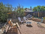 Gather around the fire pit in the private fenced backyard!