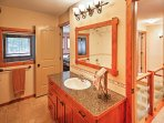 Wash up in the single vanity and shower/tub combo featured in the first bathroom.