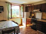 A fully equipped kitchen with  satellite TV, free Wi-Fi internet.