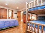 Bedroom 2 with queen and twin bunk beds, 42' flat screen TV plus en suite bath and quaint sitting area.