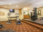 Fitness room with free weights and cardio equipment.