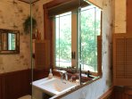 ADK decorated bath in natural wood, birch design walls and lots of light & ventilation
