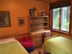 Guest B/R with 2 twins, storage & lots of air and light & forest views
