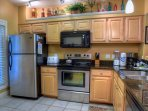 Stainless steel appliances and granite counter tops .