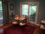 Den off the kitchen is perfect for reading and dining for a small group.  Access  to the deck.
