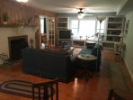 Large living room with fireplace, game table and plenty of seating. DVD movie library for TV, too.