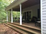 River facing deck easily seats 12+.  Glider, 2 rocking chairs, table and 4 chairs with more avail