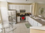 Kitchen with full size, stainless steel appliances