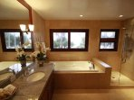 This Hale Koa Master bathroom comes complete with jet tub, stand up shower, dual sinks
