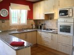 Fully fitted kitchen with dishwasher, washing machine, fridge freezer