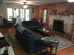 Large living room with fireplace, game table and plenty of seating.