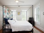 Master bedroom on second floor with king-sized bed, ensuite bathroom, private porch.